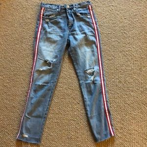 ripped light wash jeans with red stripe